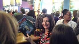 signing books at our Book Release Party
