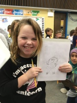 students drawing their own Ava the Monster Slayer at Forest Glen Elementary