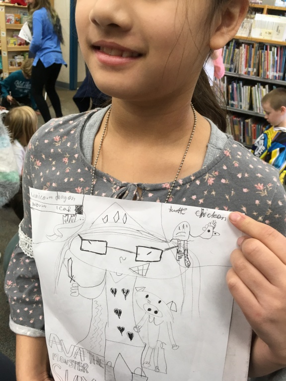 A student showing off their own Ava the Monster Slayer at Forest Glen Elementary